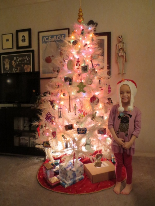 Greta decorating the tree (Christmas 2013)
