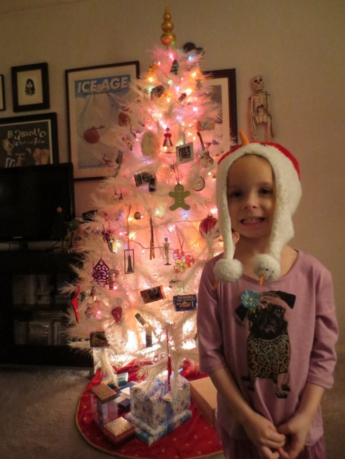 Greta decorating the tree (Christmas 2013)