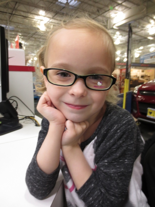 Greta getting glasses @ Costco